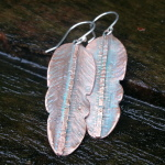 fold formed feather copper earrings